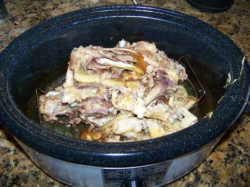 Chicken scraps in a roaster