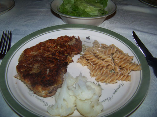 Sicilian Steak with cauliflower, salad, and pasta with garlic butter