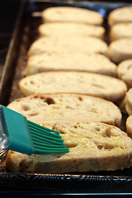 Brush bread with olive oil