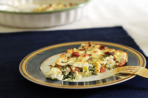 Sun dried tomato and spinach quiche served