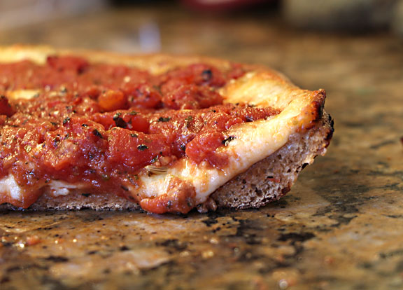 Slice of Chicago Style Deep Dish Pizza