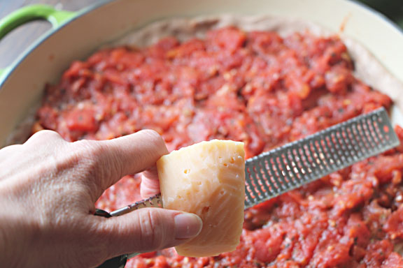 Top with sauce then grated Parmesan