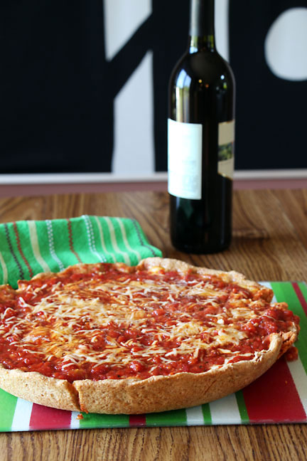 Deep Dish Pizza with wine bottle