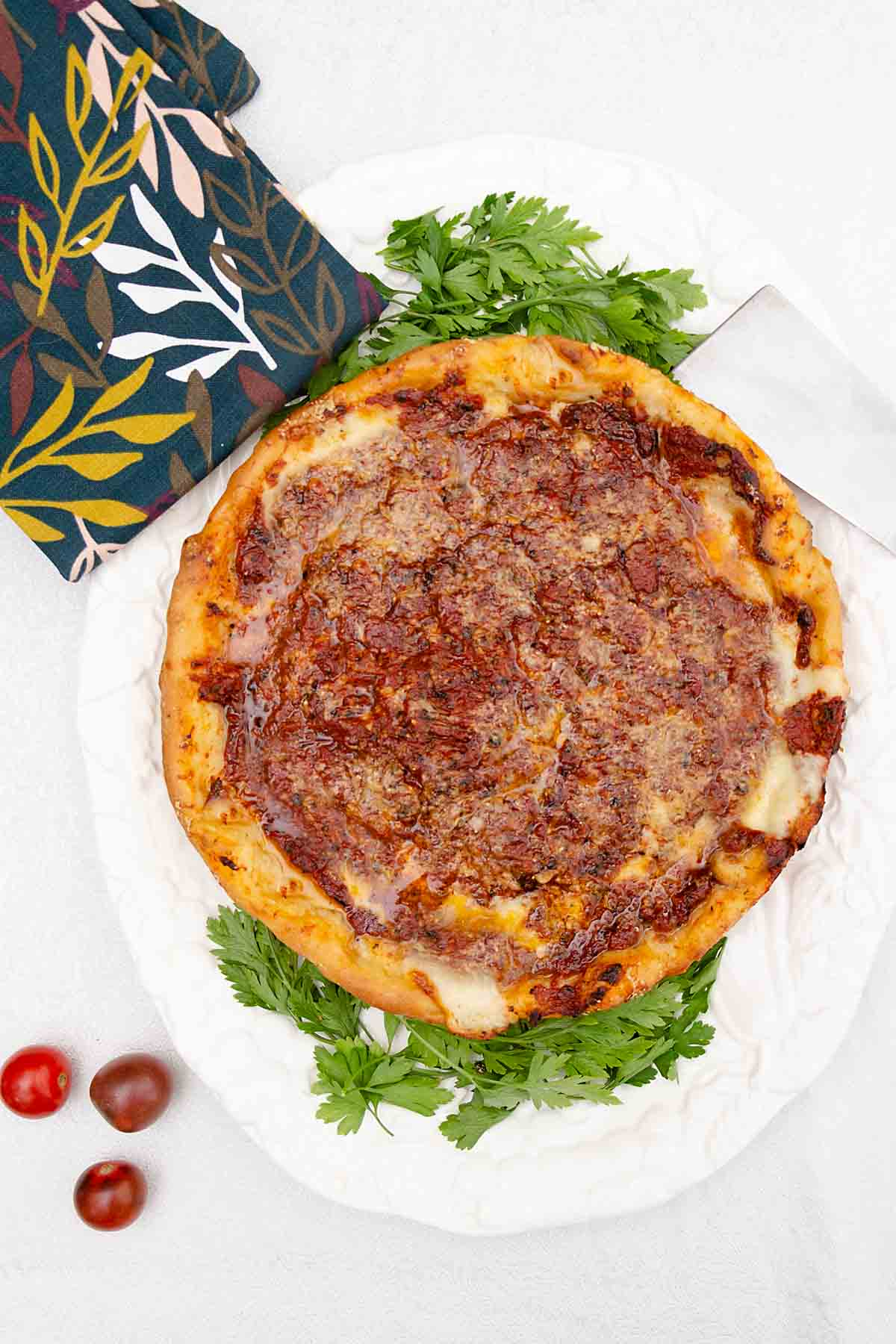 With a deep soft crust, creamy cheese and flavorful seasoned tomatoes, this Chicago Deep Dish Pizza Recipe is worth staying home for!