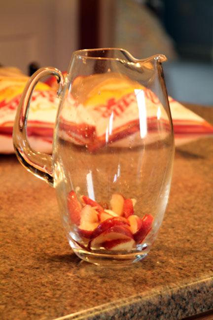 sliced fruit in Sangria pitcher