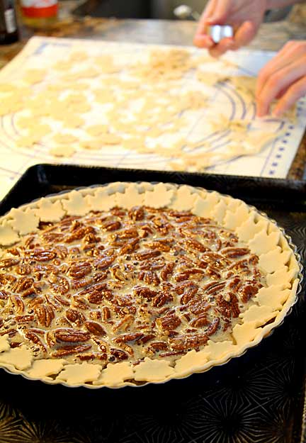 Set leaf pie crust cookies around edge of tart