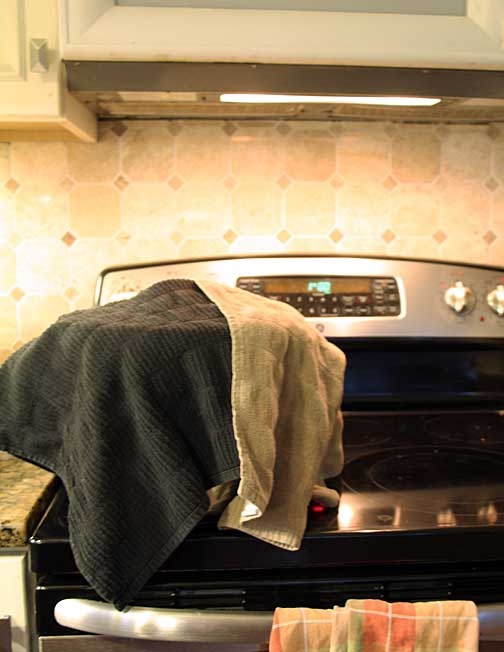 Homemade feta cooking pot covered in towels