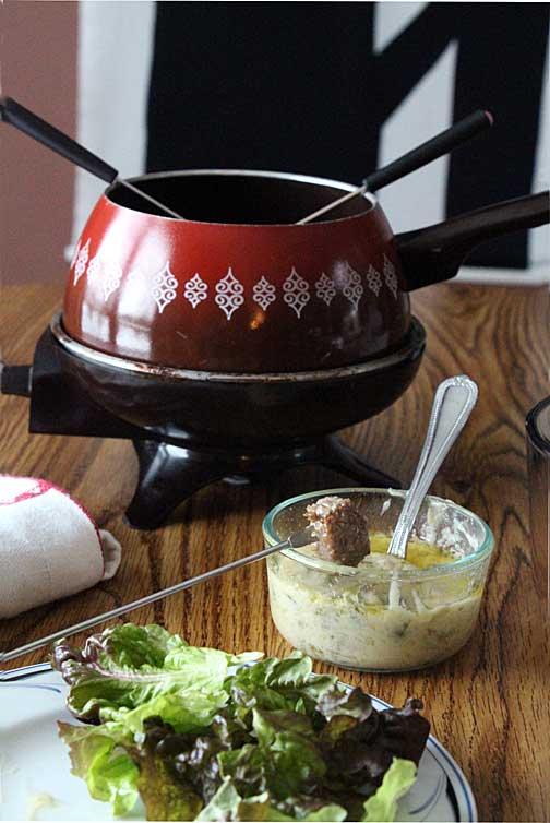 Steak fondue on table