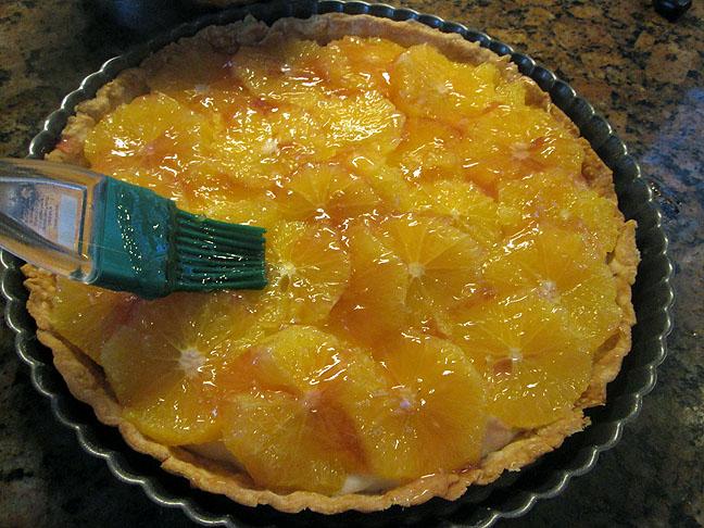 Brush diluted jelly on coconut orange tart