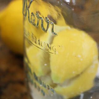Filling jar with lemons and salt
