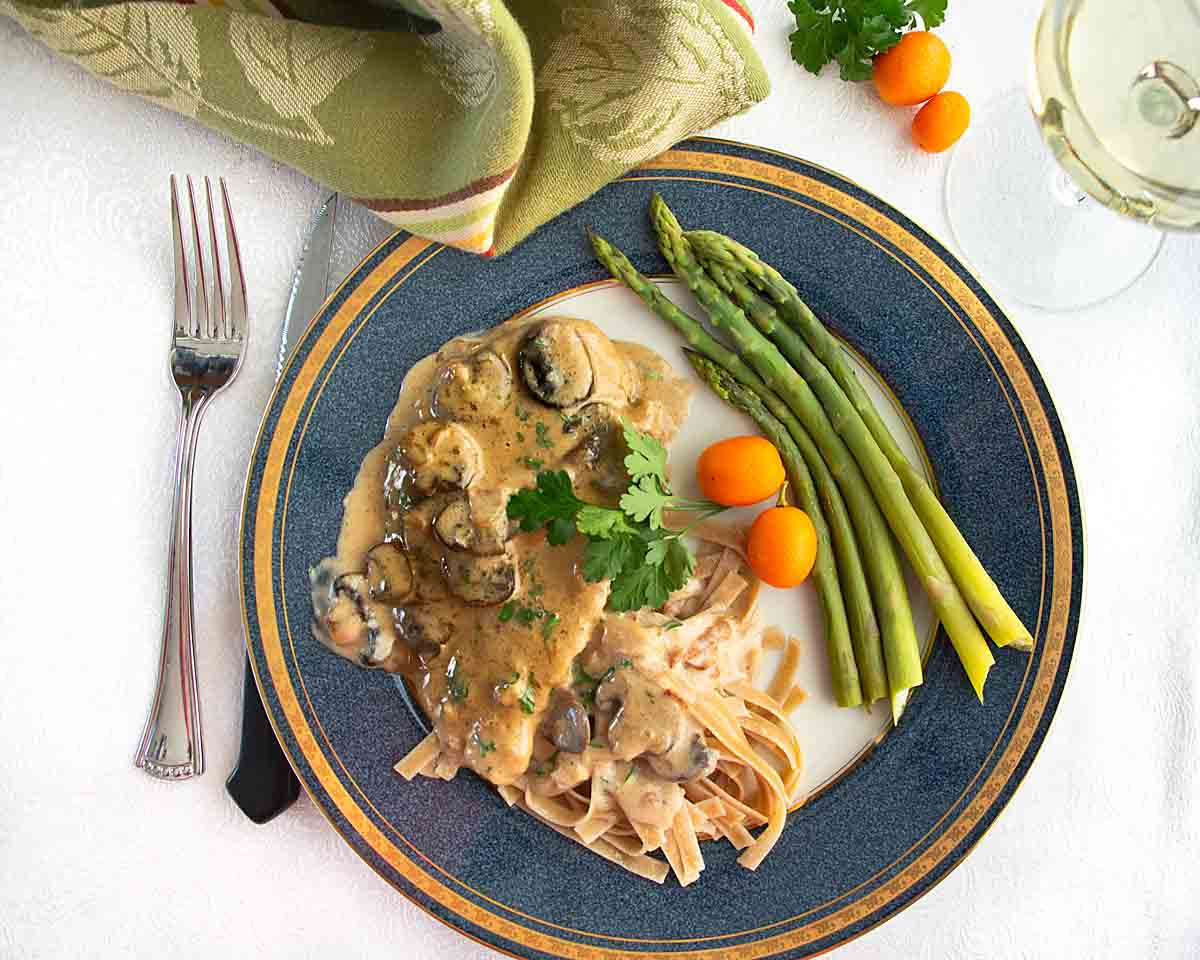 Tender browned chicken breast in a mushroom wine sauce, Chicken Marsala is an easy entree that's company worthy! Serve with pasta & a vegetable.