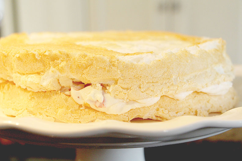 Layer meringue layers with strawberry whipped cream