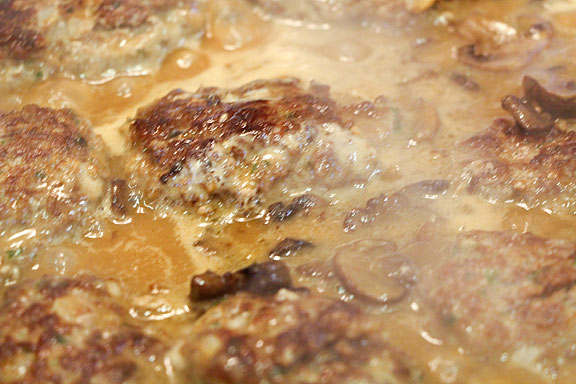 Salisbury Steak simmering in gravy