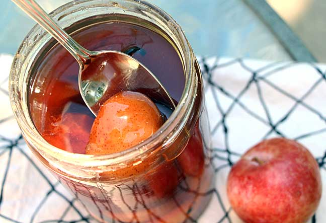 dipping-into-brandied-plums