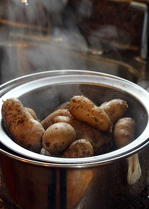 Boil potatoes, then drain
