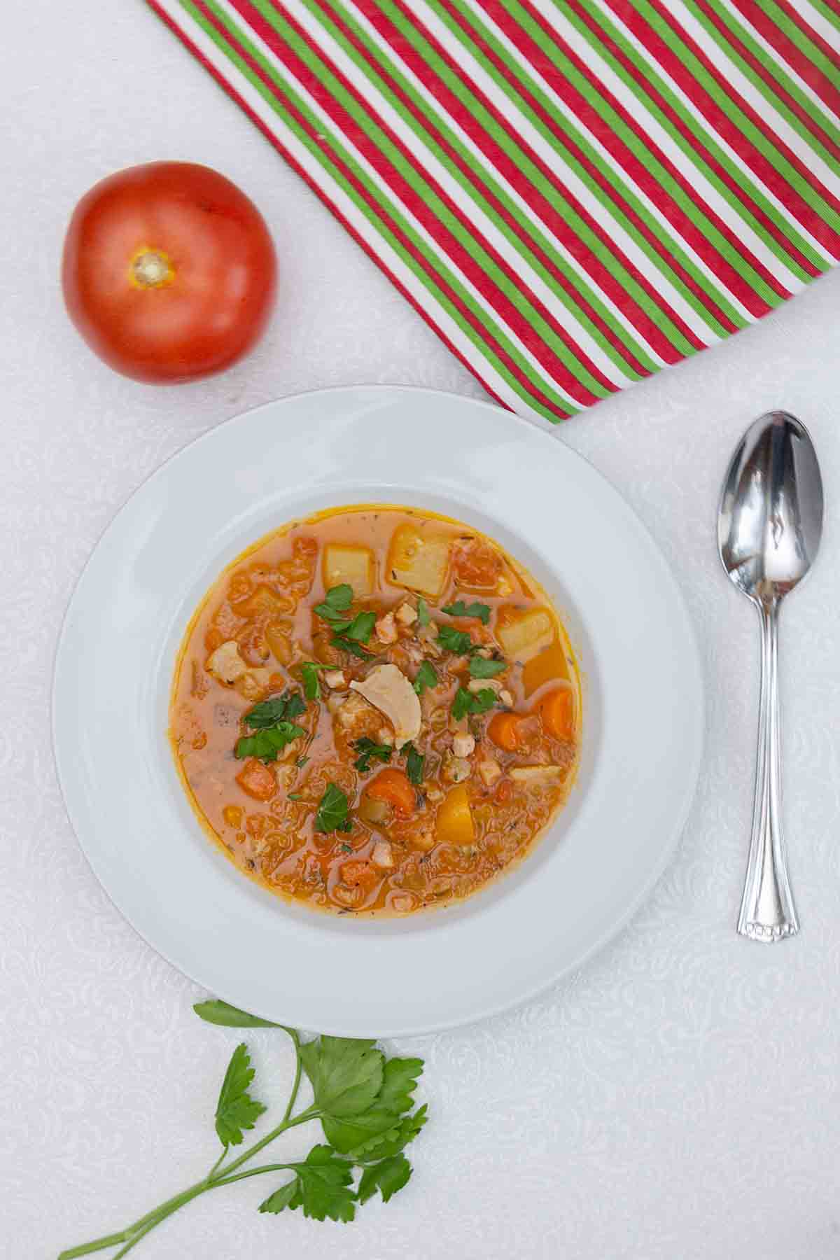 With clams, bacon, potatoes and veggies swimming in a rich tomato broth, Manhattan Clam Chowder is a perfect first course or entree soup.