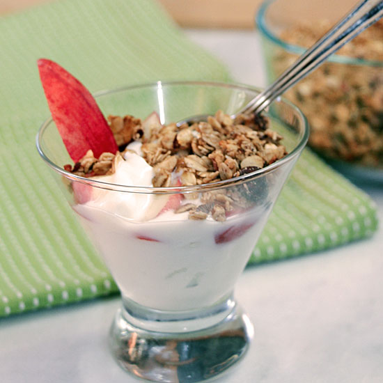 Top yogurt with home.made peach granola and a slice of peach