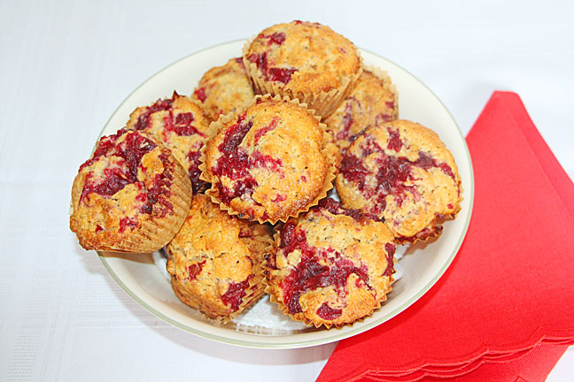 A bowl full of cranberry swirl muffins