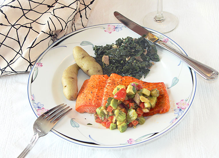 Salmon with fruit salsa, served with kale and fingerlings