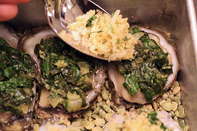 Top Oysters Rockefeller with Spinach and Seasoned Bread Crumbs