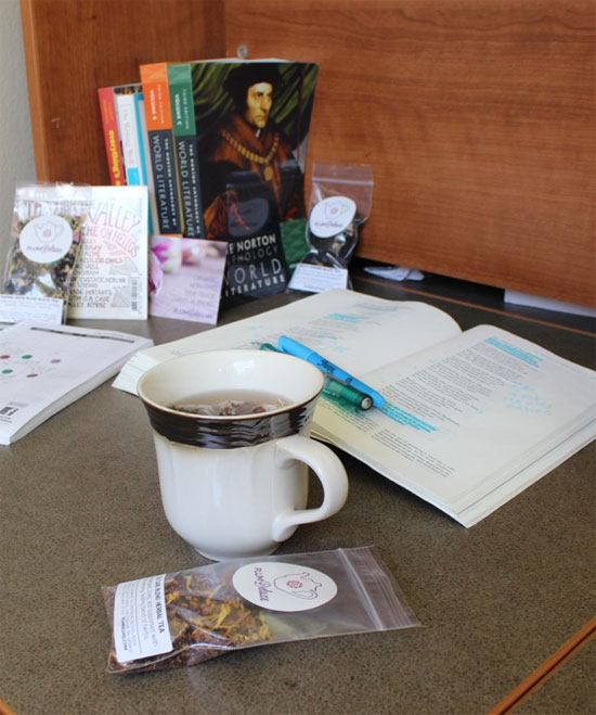 Plum Deluxe organic tea on desk