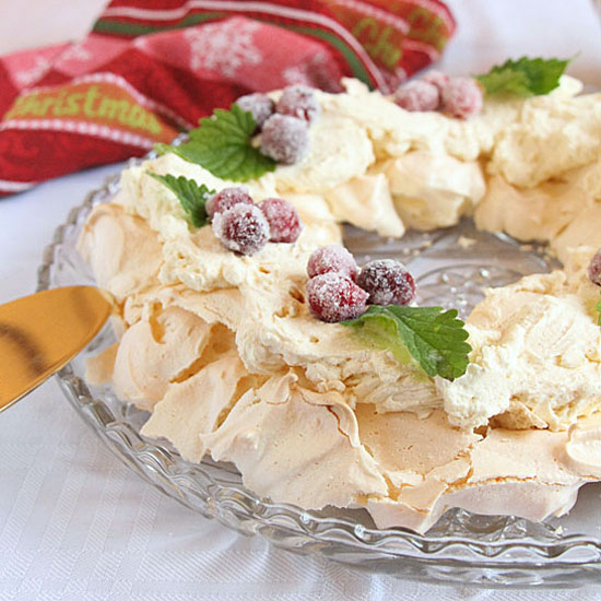 Garnish Pavlova Wreath with Sugared Cranberries and Mint Leaves