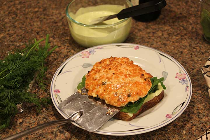 Top with mixed greens and salmon burger