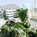 Bite of Roasted Frozen Broccoli in Tahini Sauce