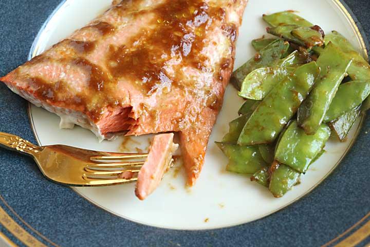 BIte of miso glazed salmon and snow peas
