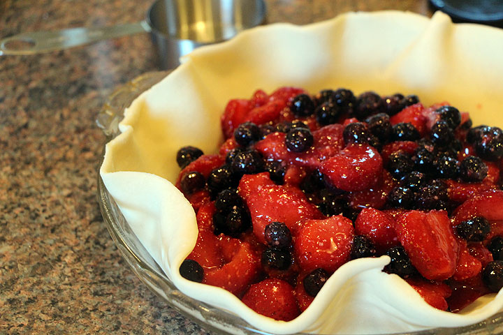 Form the Strawberry Blueberry Galette.