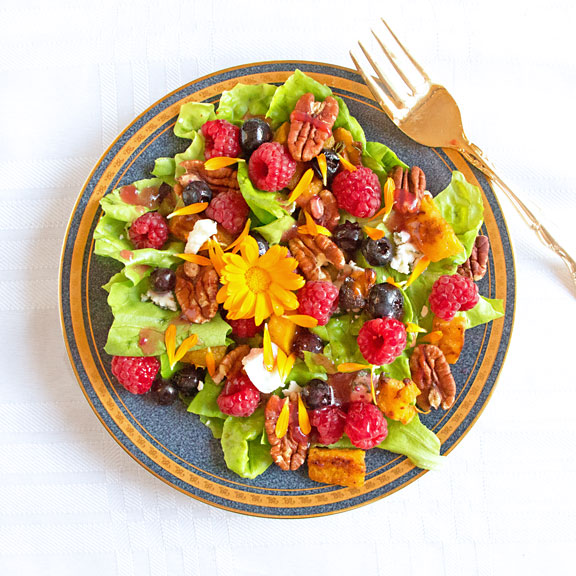 With tender lettuce, topped with sweet berries, pecans and butternut, this Fall Colors Berry Salad will rock your dinners. Eat a rainbow!