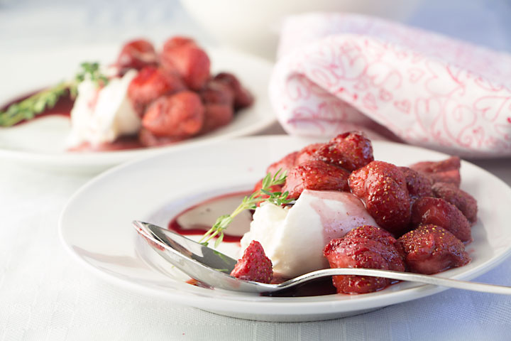 Burrata is like a pillow of fresh cheese filled with soft curd and cream. Top it with roasted strawberries and a red wine sauce for a special dessert.