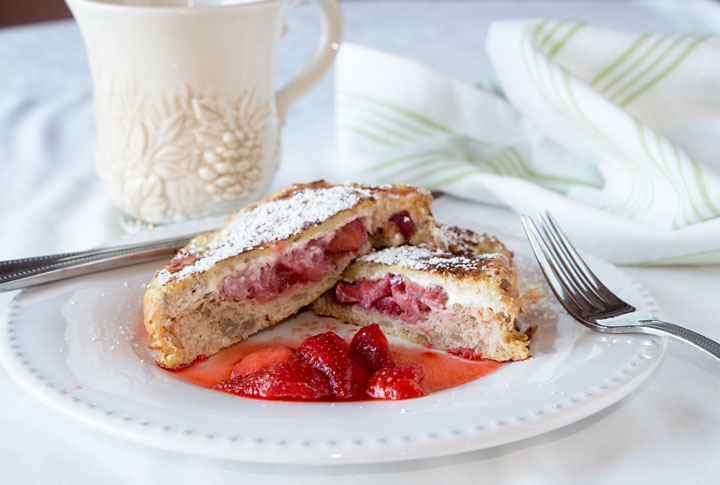 Strawberry Stuffed French Toast--custard-y bread filled with cream cheese and berries. Easy, tasty, and healthier than plain French toast.