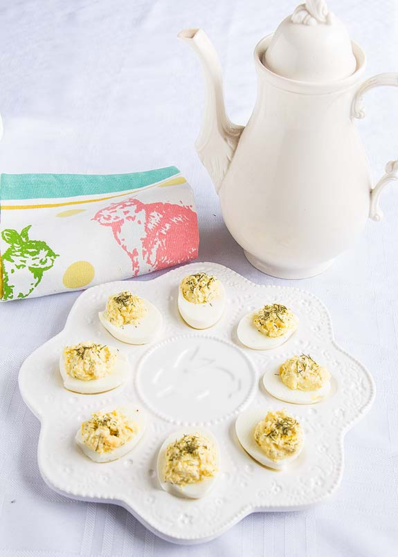 """""""Wow is there feta in here?"""" Yup, they're Greek Deviled Eggs, with tangy feta and savory dill. Perfect for picnics, Easter or Mother's Day!"""