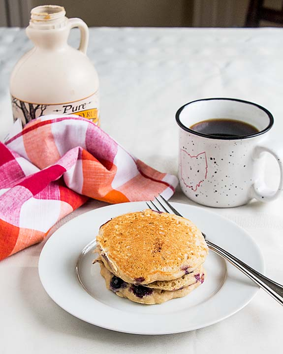 """Fluffiest whole wheat buttermilk pancakes ever! White whole wheat flour lightens the """"wheat-y"""" taste & whole wheat pastry flour adds tenderness. Mmmm!"""