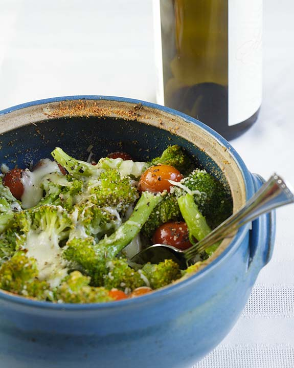 Broccoli topped with basil, fresh mozzarella, Parmesan and cherry tomatoes, Broccoli Cheese Casserole is perfect as a healthy side or main dish.