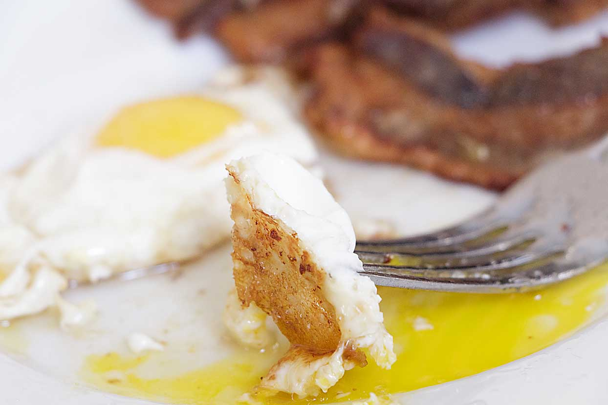 "Who would have thought fried eggs could be ""a thing!"" Best ever is a sunny side up fried egg, cooked in bacon fat until crisp!"