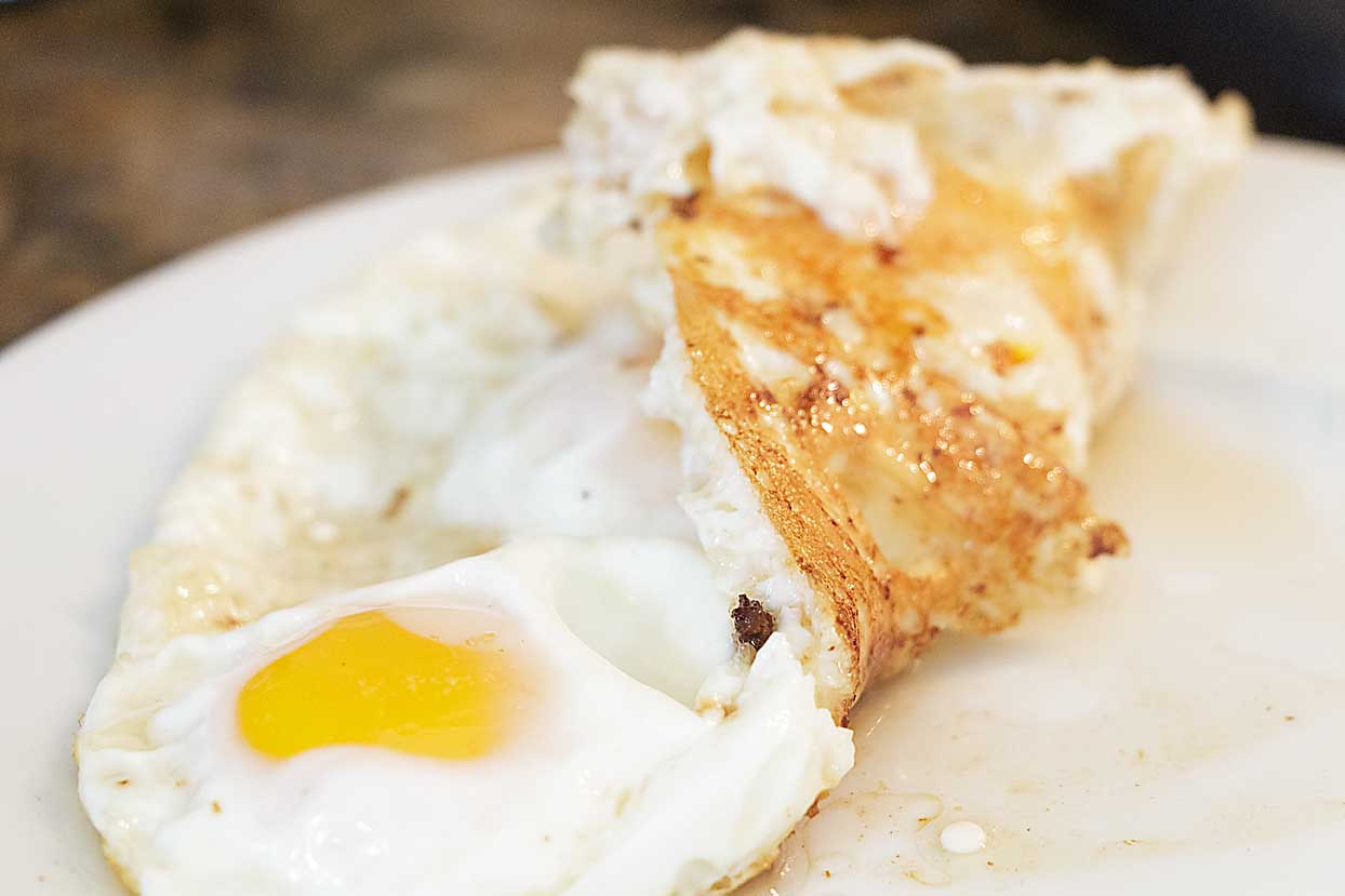 """Who would have thought fried eggs could be """"a thing!"""" Best ever is a sunny side up fried egg, cooked in bacon fat until crisp!"""