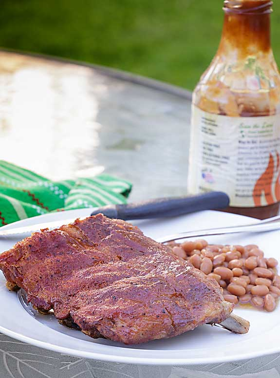 Easy Oven BBQ Ribs require almost no tending for a perfect dinner. Meaty, flavorful and meltingly tender! Celebrate summer!