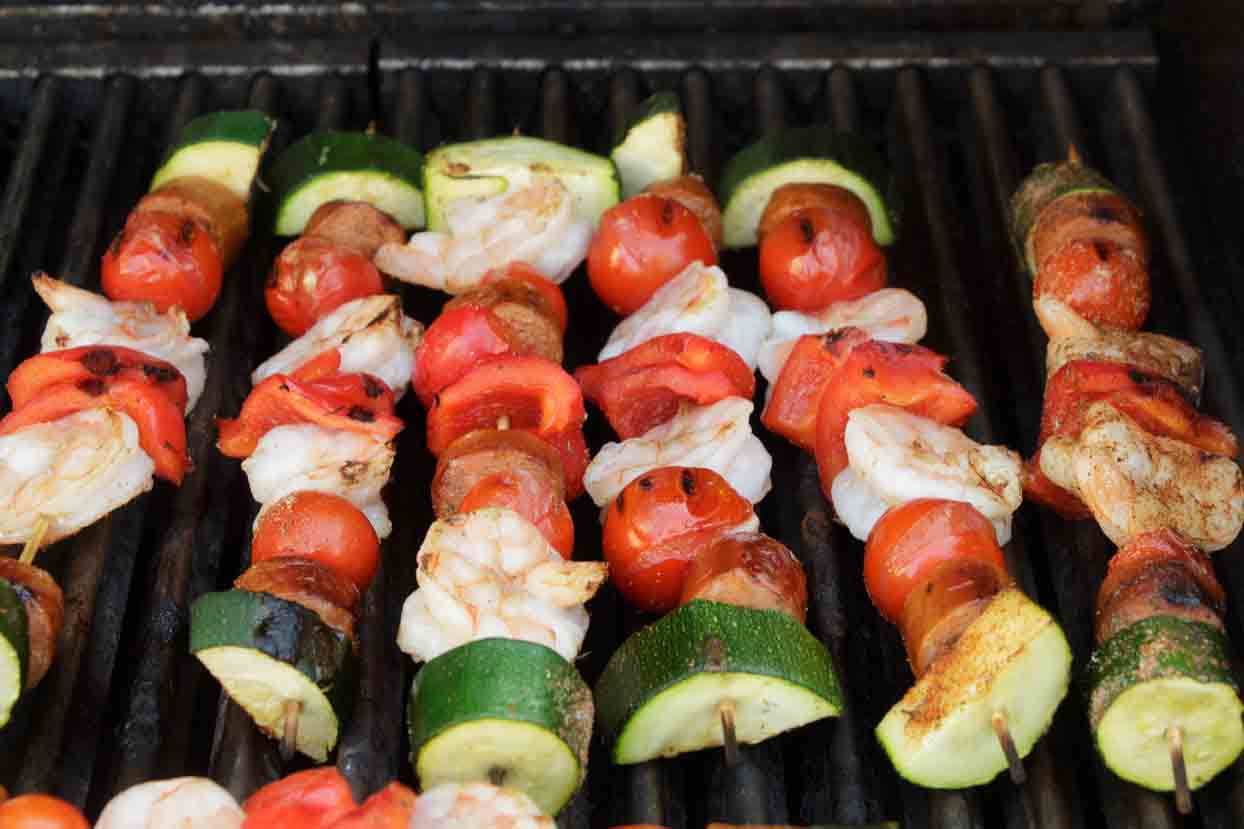 Just assemble and grill these easy cajun shrimp kabobs--no marinating! With a sprinkle of spices and andouille sausage, they are loaded with flavor!