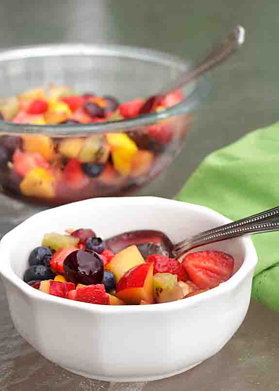 A variety of cut fruit topped with a sugar & orange juice, draws out juices & creates an amazing sauce for this simple fruit salad.In a couple hours—magic!
