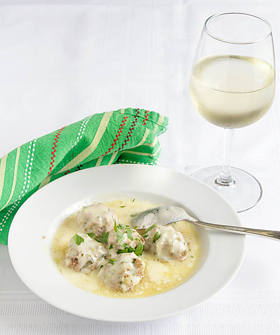 Tender meatballs in a rich beef broth, Greek Meatballs in Egg Lemon Broth is delicious paired with Greek Salad and crusty bread.
