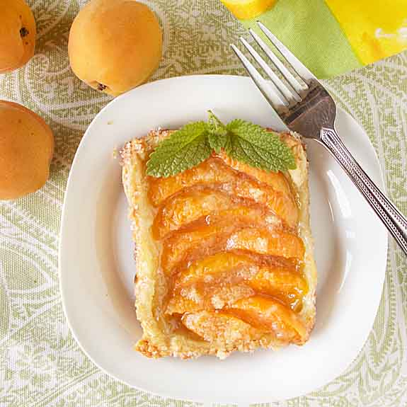 This simple apricot tart recipe is perfect for making single tarts—or serving a crowd. It also works great with peaches or pears.