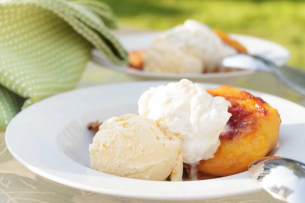 Grilled Peaches and Pound Cake, topped with vanilla ice cream, is simple perfection at it's best. Just add whipped cream.