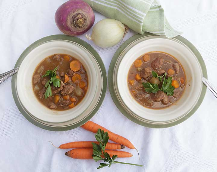"""A healthier version of the traditional stew, with added vegetables, Guinness Lamb Stew is rich, meaty, and reminiscent of a the """"old country."""""""