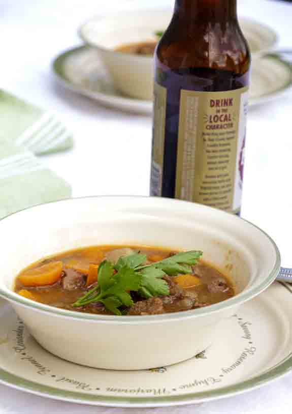 """A healthier version of the traditional stew, with added vegetables, Guinness Lamb Stew is rich, meaty, and reminiscent of a the """"old county."""""""
