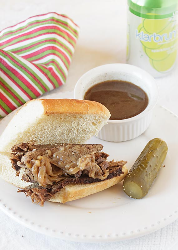 """Savory Roast Beef on crusty French bread, accompanied by a tasty dip (""""au jus""""), the French Dip Sandwich is a special lunch treat."""
