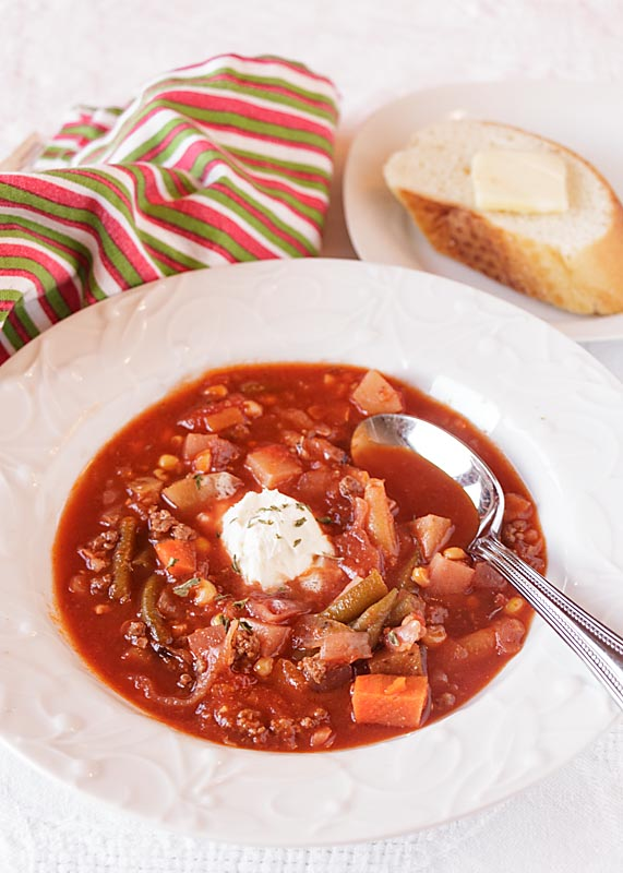 This Hearty Ground Beef Vegetable Soup is loaded with lots of colorful vegetables in a rich tomato broth. Eat a rainbow!