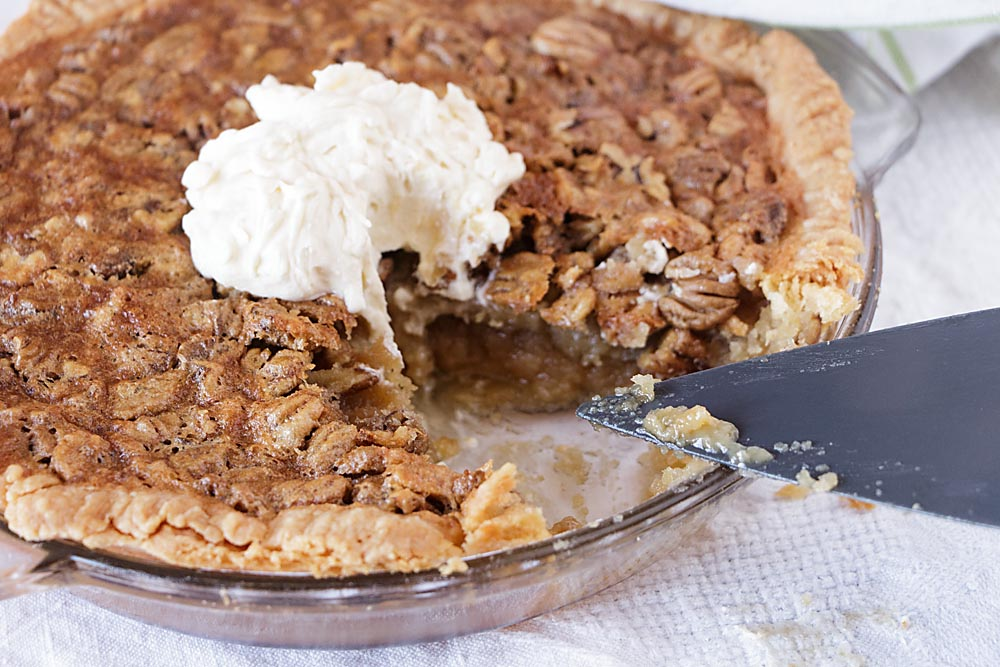 Sweet and nutty and flavored with maple, this maple nut pie (aka pecan pie) is a delicious treat for any special occasion. All natural, with no corn syrup, there are instructions for making a mini-pie for 2-4 or a full-sized pie.