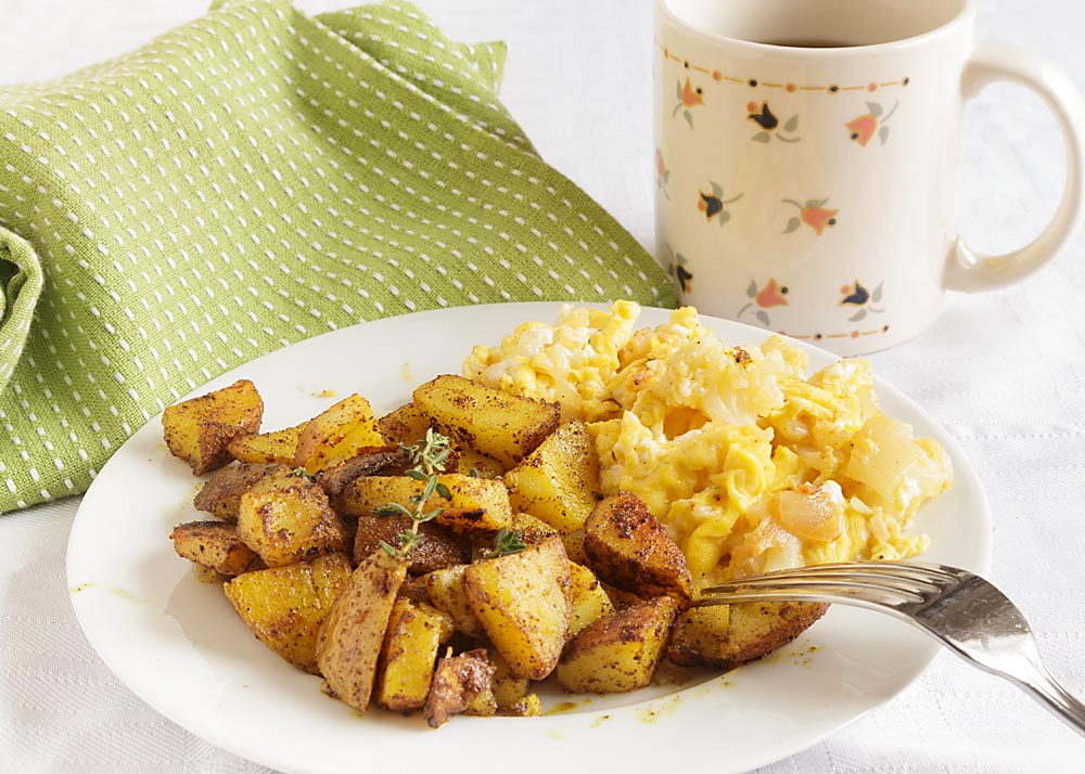 Spicy fried breakfast potatoes blend the comfort of fried potatoes with the flavor, color and antioxidant properties of turmeric and other spices! Gotta love comfort food!